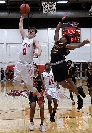 NOC Enid's IAndrew O'Brien goes up for a fastbreak dunk against Redlands' James Alexandre Thursday, February 20, 2020 at the NOC Mabee Center. (Billy Hefton / Enid news & Eagle)