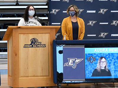 Audra hempfling addresses those attending Enid High School's signing day with coach Lyndsey Watts looking on Wednesday, February 3, 2021 at the Enid High School gym. (Billy Hefton / Enid News & Eagle)