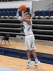 Enid's Taye Sullivan puts up a three point shot against Choctaw Friday, February 5, 2021 at Enid High School. (Billy Hefton / Enid News & Eagle)
