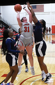 NOC Enid's Lauren Wade shoots over Seminole's Tiffany Robinson Thursday, February 4, 2021 at the NOC Mabee Center. (Billy Hefton / Enid News & Eagle)