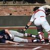 NOC Enid's Jordan Coffey tags Hutchinson CC's P.J. Loucks at David Allen Memorial Ballpark Tuesday, February 2, 2021. Loucks was called safe on the play. (Billy Hefton / Enid News & Eagle)