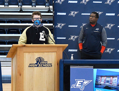John Gay addresses those attending Enid High School's signing day with coach Rashaun Woods looking on Wednesday, February 3, 2021 at the Enid High School gym. (Billy Hefton / Enid News & Eagle)