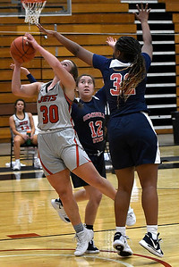 NOC Enid's Madelyn Hankins puts up a shot between between Seminole's Tiffany Robinson and Jayla McIntosh Thursday, February 4, 2021 at the NOC Mabee Center. (Billy Hefton / Enid News & Eagle)