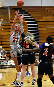 NOC Enid's Kristen Readel puts up a shot against Seminole's Caya Wright Thursday, February 4, 2021 at the NOC Mabee Center. (Billy Hefton / Enid News & Eagle)