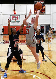 NOC Enid's Lauren Wade puts up a shot against Seminole's Rhys Anderson Thursday, February 4, 2021 at the NOC Mabee Center. (Billy Hefton / Enid News & Eagle)