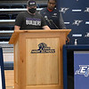 Nate Gamble addresses those attending Enid High School's signing day with coach Rashaun Woods looking on Wednesday, February 3, 2021 at the Enid High School gym. (Billy Hefton / Enid News & Eagle)