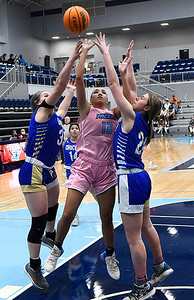 Enid's Lanie Goins puts up a shot between Choctaw's Jazmin Adams and Hannah Smith Friday, February 5, 2021 at Enid High School. (Billy Hefton / Enid News & Eagle)