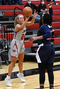 NOC Enid's Hollie Wood shoots over Seminole's Tatiana Gilford Thursday, February 4, 2021 at the NOC Mabee Center. (Billy Hefton / Enid News & Eagle)