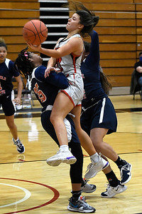 NOC Enid's Abbey Phibbs puts up a shot in th elane against Seminole's Tatiana Gilford Thursday, February 4, 2021 at the NOC Mabee Center. (Billy Hefton / Enid News & Eagle)