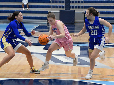 Enid's Claire Dodds dribbles between Choctaw's Brooke Curry and Trinity Gooden Friday, February 5, 2021 at Enid High School. (Billy Hefton / Enid News & Eagle)