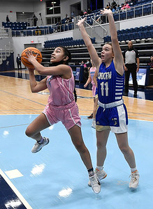 Enid's Jasia Malolo gets by Choctaw's Bre Curry for a shot Friday, February 5, 2021 at Enid High School. (Billy Hefton / Enid News & Eagle)