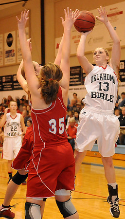 OBA's Brooke Wayman scores over two Chisholm Lady Longhorns Tuesday at Oklahoma Bible Academy. (Staff Photo by BONNIE VCULEK)