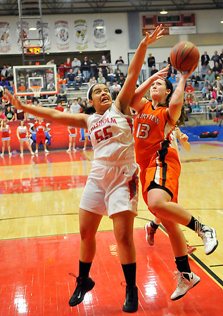 Fairview's Baylor Reese goes up against for a shot against Chisholm's Emily Raynor Friday during the semi-finals of the 44th Annual Wheat Capital Basketball Tournament at Chisholm High School. (Staff Photo by BILLY HEFTON)