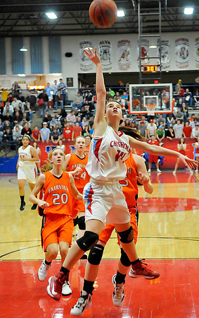 Chisholm's Megan Galusha scores a faskbreak basket against Fairview Friday during the semi-finals of the 44th Annual Wheat Capital Basketball Tournament at Chisholm High School. (Staff Photo by BILLY HEFTON)