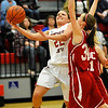 NOC-Enid's Shelby Layn puts up a shot against Deborah Means of NOC-Tonkawa Monday at the NOC Mabee Center. (Staff Photo by BILLY HEFTON)