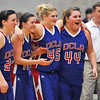 DCLA seniors, Karen Golay, Marian Muegga, Haley Stacy, and Katy Starr, wait to accept to accept the championship trophy from the Cherokee Strip Conference Tournament after defeating Lomega 61-57 January 26, 2013. (Staff Photo by BILLY HEFTON)