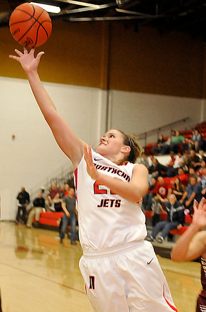 NOC-Enid's Rylie Swanson lays the ball up against Redlands Monday at the NOC Mabee Center. (Staff Photo by BILLY HEFTON)