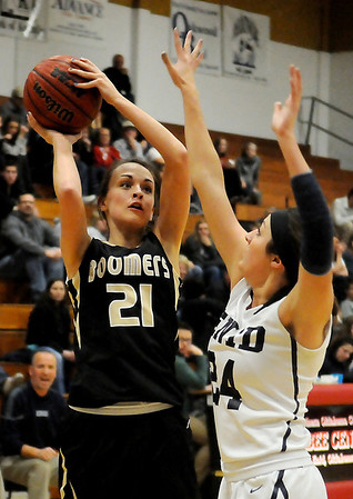 Woodward's Mercedeez Bell (left) shoots against Enid's Grace Enmeier at the Northern Oklahoma College-Enid Mabee Center Tuesday, Jan. 29, 2013. The Enid Pacers defeated the Woodward Lady Bombers 56-32. (Photo Courtesy of Enid News & Eagle, BONNIE VCULEK)