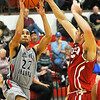 NOC-Enid's Jeremy Espinoza puts up a shot over JJ Nganga of NOC-Tonkawa during a game earlier this season at the NOC-Enid Mabee Center. (Staff Photo by BILLY HEFTON)