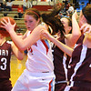 Chisholm's Morgan Lawver snags an offensive board for a put back agaisnt three Perry Lady Maroons Thursday, Jan. 10, 2013, during the Wheat Capital Basketball Tournament at Chisholm High School. (Staff Photo by BONNIE VCULEK)