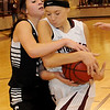 Pioneer's Shelby Flavell (right) grabs an offensive rebound against a Pond Creek-Hunter player Friday, Jan. 18, 2013, during the Lady Panther's win over the Lady Mustangs at Pioneer High School. (Staff Photo by BONNIE VCULEK)