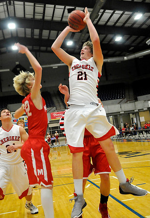 Cherokee's Grant DeWitt shoots over Medfords's Jack States during the championship game of the Cherokee Strip Conference Tournament January 26, 2013. (Staff Photo by BILLY HEFTON)