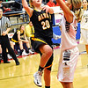 Alva's Jayna Hadwiger puts up a shot over Kingfisher's Kylee Blehm during the semi-finals of the 44th Annual Wheat Capital Basketball Tournament at Chisholm High School. (Staff Photo by BILLY HEFTON)