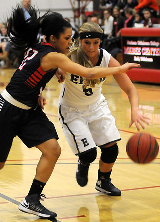 Enid's Haven Bay drives against Ponca City's Brianne Cherry during the Pacers' win over the Lady Cats at the Mabee Center Thursday, Jan. 31, 2013. (Staff Photo by BONNIE VCULEK)