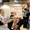 Pond Creek-Hunter's Brady Krittenbrink rebounds under the Pioneer Mustang's basket against Pioneer's Colby Koontz Friday, Jan. 18, 2013. (Staff Photo by BONNIE VCULEK)