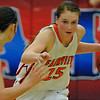 Fairview's Olivia Mason dribbles upcourt against pressure from Alva's Jaden Hobbs during the finals of the 44th annual Wheat Capital Basketball Tournament Saturday at Chisholm High School. (Staff Photo by BILLY HEFTON)