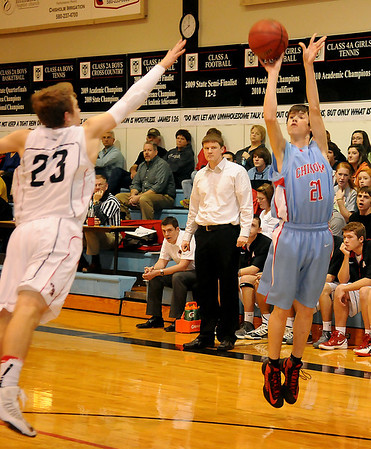 Chisholm's Trevor Galusha launches the ball for Chisholm's first three against OBA's Preston Atwood Tuesday at Oklahoma Bible Academy. (Staff Photo by BONNIE VCULEK)