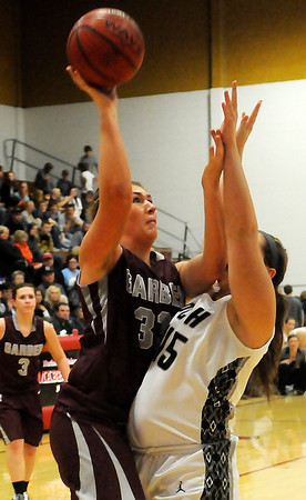Garber's Madeline Leathers shoots over the outstretched arms of Pond Creek-Hunter's Taylor Fetters during the 89th annual Skeltur Conference Basketball Tournament Championship at the Mabee Center Saturday, Jan. 26, 2013. (Staff Photo by BONNIE VCULEK)