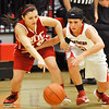 NOC-Enid's Chelsea Bates knocks the ball away from Rachel Butler of NOC-Tonkawa Monday at the NOC Mabee Center. (Staff Photo by BILLY HEFTON)