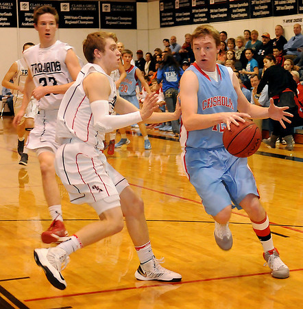 Chisholm's Caleb Lang sprints up the court for a score as OBA's Preston Atwood defends Tuesday at Oklahoma Bible Academy. (Staff Photo by BONNIE VCULEK)