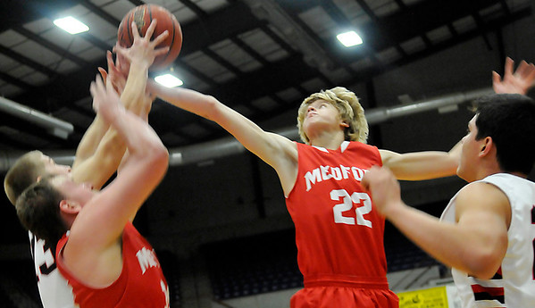 Medford's Jack States stretches for a rebound against Cherokee during the championship game of the Cherokee Strip Conference Tournament January 26, 2013. (Staff Photo by BILLY HEFTON)