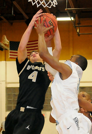 Woodward's Kaleb Roach and Enid's Michael Walker tie up under the Plainsmen hoop at the NOC-Enid Mabee Center Tuesday, Jan. 29, 2013. (Photo Courtesy of Enid News and Eagle, BONNIE VCULEK)