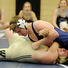 Enid's Hank Schultz pins Woodward's Cole Reynolds during the 170 pound match Tuesday. The Plainsmen defeated the Bombers 42-36. (Staff Photo by BONNIE VCULEK)