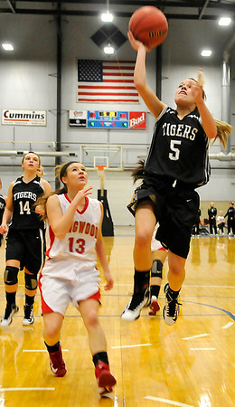 Timberlake's Karly LaForce scores a fast break basket ahead of Ringwood's Alex Hayes during the first round of the Cherokee Strip Conference Tournament January 24, 2013. (Staff Photo by BILLY HEFTON)