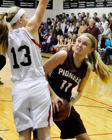Pioneer's Lexsie Mann looks for a shot while being defended by OBA's Brooke Wayman  Tuesday at the OBA gym. (Staff Photo by BILLY HEFTON)