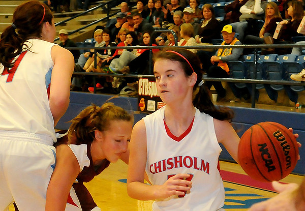 Chisholm's Megan Galusha (right) drives the baseline and scores as teammate Morgan Lawver assists against a Perry defender Thursday, Jan. 10, 2013, during the Wheat Capital Basketball Tournament at Chisholm High School. (Staff Photo by BONNIE VCULEK)