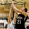 Pioneer's Blake Gabriel puts up a shot over OBA's Dylan WhiteZ  Tuesday at the OBA gym. (Staff Photo by BILLY HEFTON)