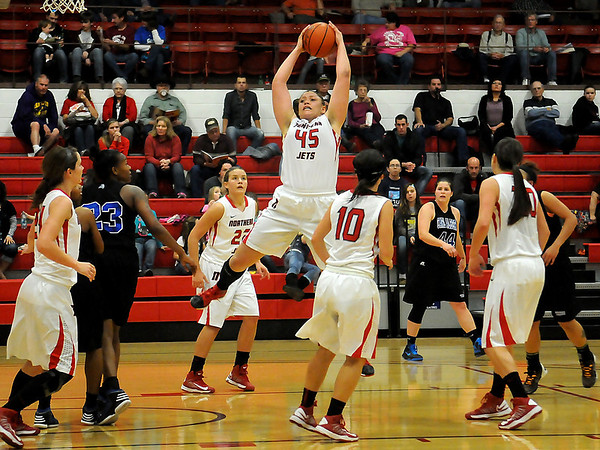 NOC-Enid's Marisha Wallace skies for the rebound against the Carl Albert Lady Vikings Wednesday. The Lady Jets won 64-53. (Staff Photo by BONNIE VCULEK)
