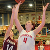 Chisholm's Morgan Lawver uses a soft touch to score two against Perry's Chelsea Deterding Thursday, Jan. 10, 2013, during the Wheat Capital Basketball Tournament at Chisholm High School. (Staff Photo by BONNIE VCULEK)