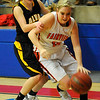 Fairview's Payton Van Meter drives toward the basket against Alva's Jayna Hadwiger during the finals of the 44th annual Wheat Capital Basketball Tournament Saturday at Chisholm High School. (Staff Photo by BILLY HEFTON)