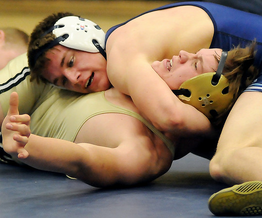 Enid's Hunter Nixon pins Woodward's Tyler Tuck in the 160 pound weight class during the Plainsmen's 42-36 match win at Waller Middle School Tuesday. (Staff Photo by BONNIE VCULEK)