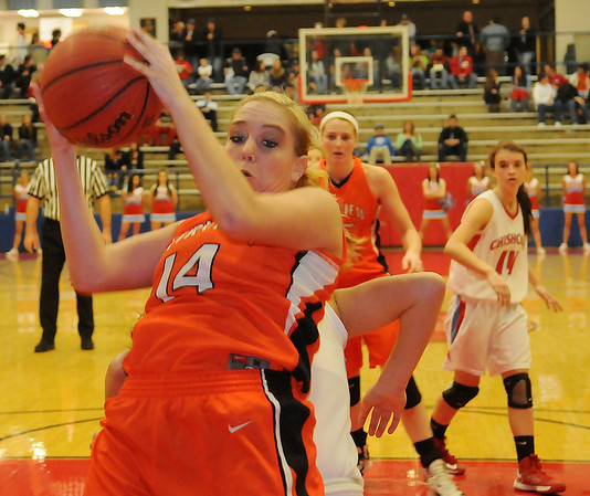 Fairview's Payton Van Meter grabs a rebound against the Chisholm Lady Longhorns Friday, Jan. 4, 2013, during the Lady Yellowjackets 54-21 victory at the Paul J. Outhier Field House. (Staff Photo by BONNIE VCULEK)