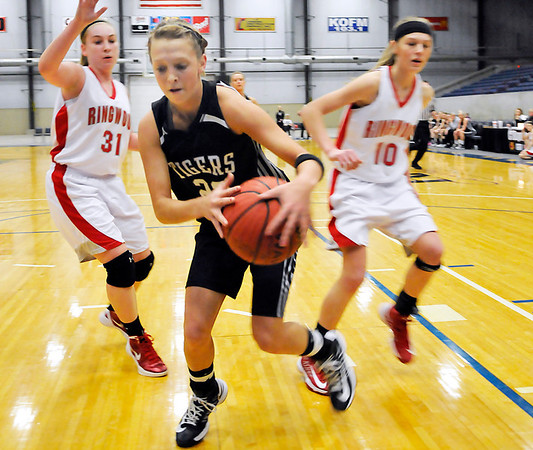 Timberlake's Kayla Castle gains control of the ball in front of  Ringwood's Lizzy Shafer and Kenzie Johnson during the first round of the Cherokee Strip Conference Tournament January 24, 2013. (Staff Photo by BILLY HEFTON)