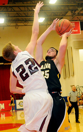 Alva's Cade Pfleider pulls up for a shot and scores over Pioneer's Nicholas Denker Thursday, Jan. 10, 2013, during the Wheat Capital Basketball Tournament at Chisholm High School. (Staff Photo by BONNIE VCULEK)