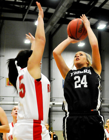 Timberlake's Bailee Clift shoots over Ringwood's Katelyn Randolph during the first round of the Cherokee Strip Conference Tournament January 24, 2013. (Staff Photo by BILLY HEFTON)