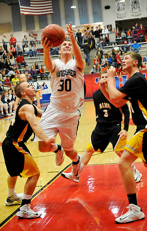 Kingfisher's Grant Newton drives through the lane against Alva Friday during the semi-finals of the 44th Annual Wheat Capital Basketball Tournament at Chisholm High School. (Staff Photo by BILLY HEFTON)